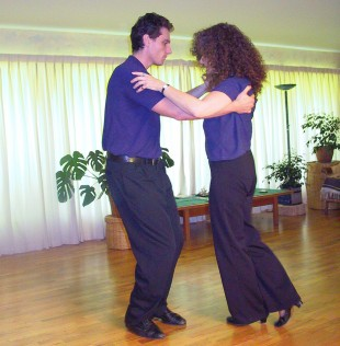 Me at a tango lesson when my hair was still auburn. Age 49.